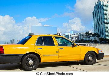 Miami beach yellow cab taxi in a bridge Florida