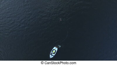 Boat floats on the river aerial view.