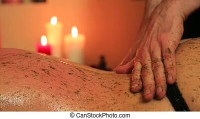 Massage with mixture of herbs for a woman.