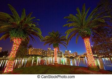 Orlando skyline sunset at lake Eola Florida US - Orlando...