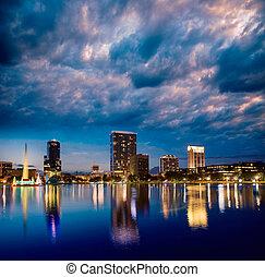 Orlando skyline sunset at lake Eola Florida US - Orlando...