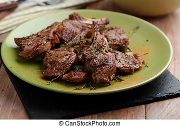 Lamb chops - Roasted lamb chops on a plate