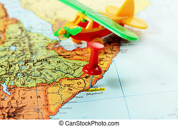 Africa map Somalia Mogadishu airplane - Close-up of a red...