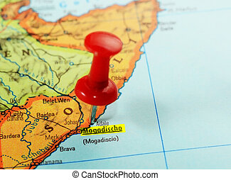 Africa map Somalia Mogadishu - Close-up of a red pushpin on...