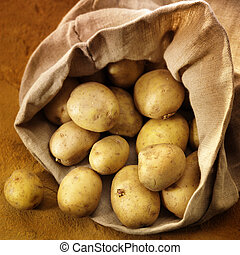 overflowing bag of potatos - rich and colourful