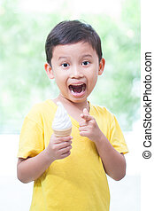 Happy asian boy eating ice-cream