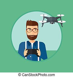 Man flying drone. - A hipster man with the beard flying...