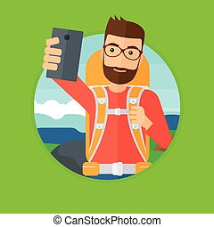Man with backpack making selfie. - A hipster man with the...
