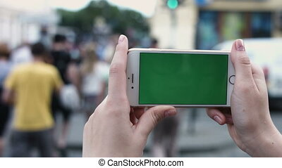 Teen Girl is Using Smartphone with Green Screen in Landscape...