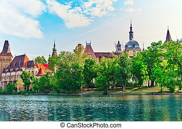Vajdahunyad Castle (Hungarian-Vajdahunyad vara) with lake...