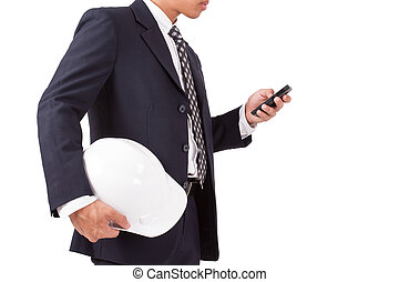 engineer holding white helmet with using smartphone isolated...