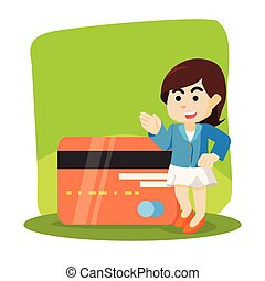 A woman standing next to big credit card