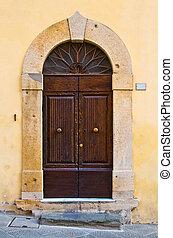 ancient wooden door of historic building - Ancient wooden...