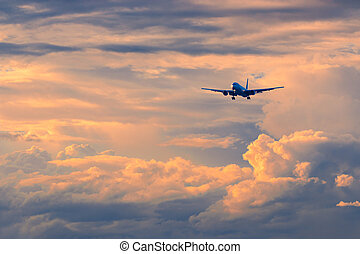 Commercial passenger airplane coming in for landing during...