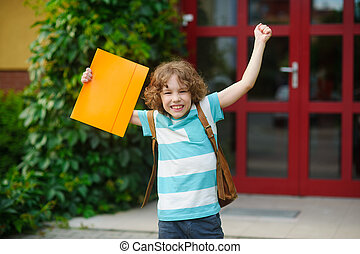 The little school student rejoices to beginning of summer vacation.