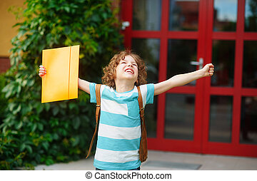 Little school student rejoices to the termination of academic year.