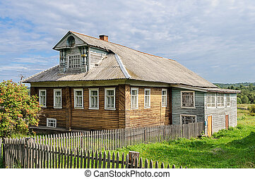 Country wooden house with mansard