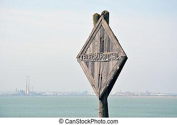 old telegraph wooden mast near the sea in Ireland