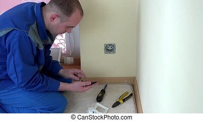 Electrician worker call mobile phone and consult with...