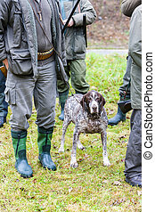 hunters with a dog at hunt