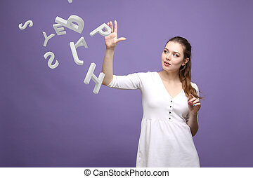 Woman working with a set of letters, writing concept - Young...