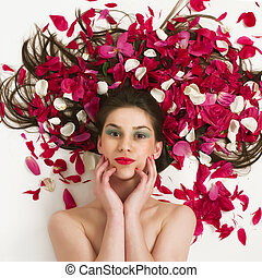 Naturaly beauty - Beautiful woman with petal\'s of red roses...