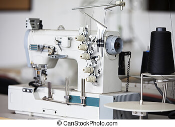 Sewing Machine In Factory - Sewing machine and thread spools...