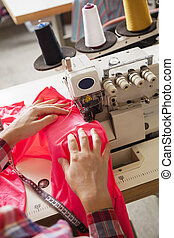 Tailor Sewing Fabric At Factory - High angle view of female...