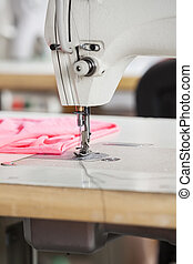 Fabric By Sewing Machine On Workbench - Pink fabric by...