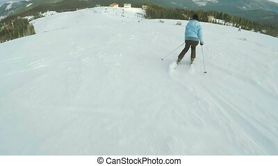 Woman Ski descent in nature - Riding on skis woman down road