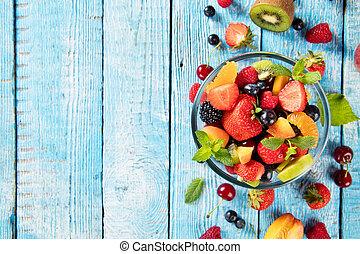 Fresh fruit salad served on wooden table - Fresh fruit salad...