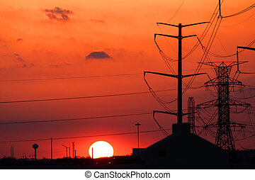 Sun set with high tension electric poles