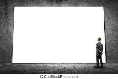 Businessman and big billboard - Rear view of businessman in...