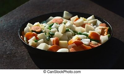 vegetable ragout in a frying pan outdoors