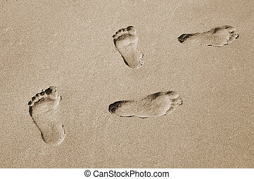 footprints in the background sand