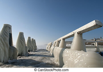 icecicles on guardrail - frozen icecicles on a guardrail,...