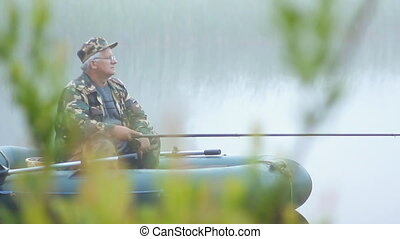 The fisherman on the boat fished Small fish on a fishing rod...