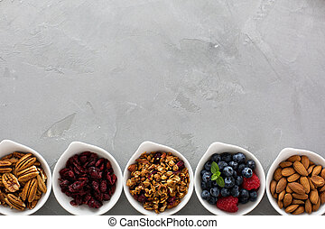 Variety of breakfast food in small bowls - Variety of...