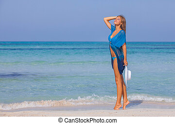 woman on beach summer holiday slim and beautiful