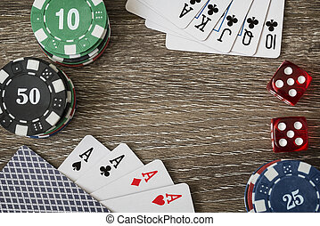 Gambling chips and poker card on wooden background