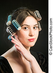 Hair care - Portrait young woman with curlers in her hair