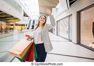 Bye bye, my dear - A photo of young, happy woman holding...