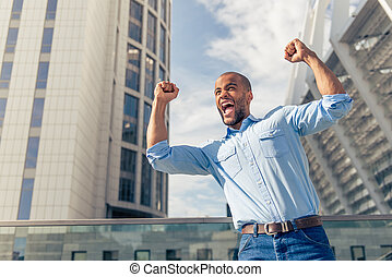 Afro American businessman - Low angle view of handsome young...