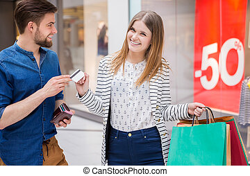 Man giving his girlfriend a credit card