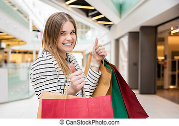 Self-satisfied girl - A photo of young, happy woman shopping...