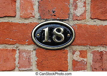 House number: 18 - white metallic number (18) hanging a...
