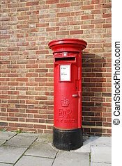 British postbox - red and vintage british postbox on the...