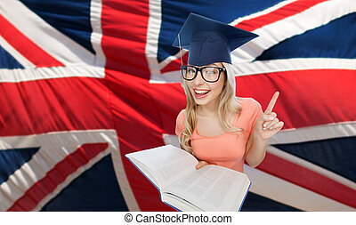 student woman in mortarboard over english flag - people,...