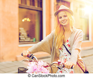 attractive woman with bicycle in the city