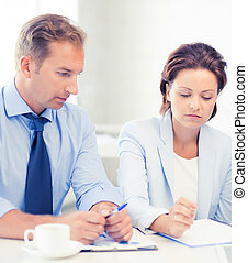 business team discussing something in office - picture of...